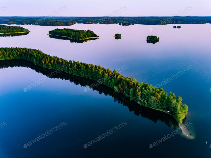 Aerial view of blue lakes with islands and green forests  in Finland.