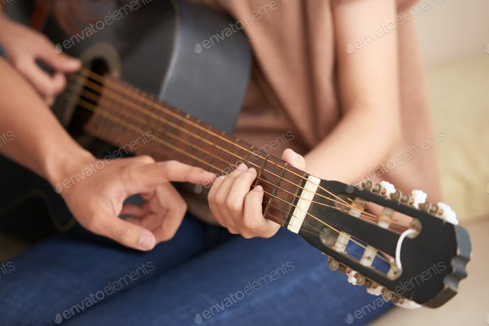 Attending guitar class