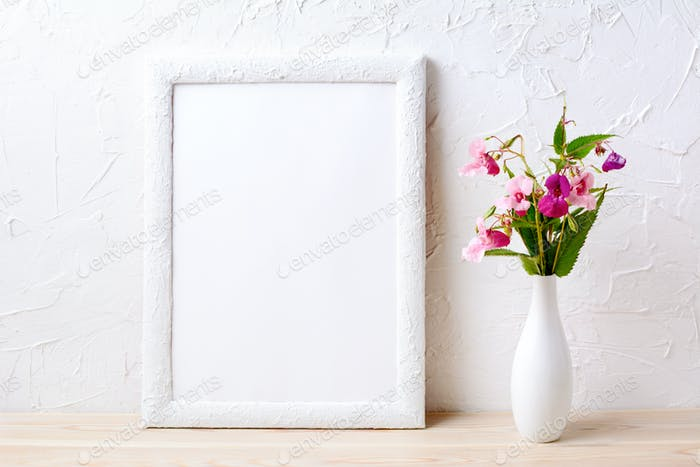 White frame mockup with pink flowers in elegant vase