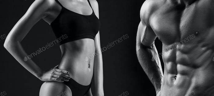 The torso of attractive male and female bodys on black background.