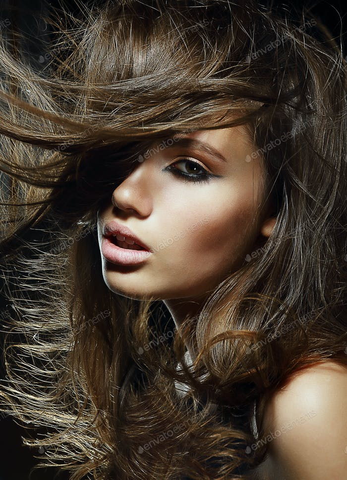 Cute woman with flowing hairs