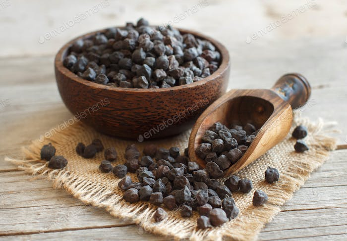 Black Chickpea in a bowl with a spoon