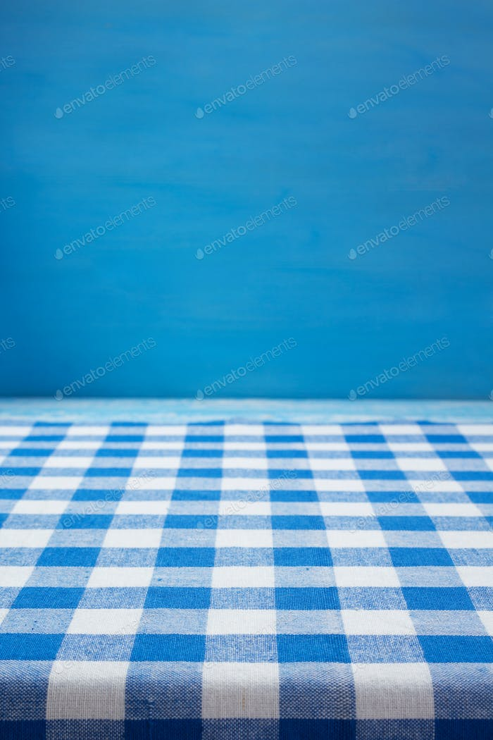 cloth napkin at rustic table wooden background