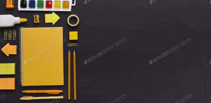Yellow stylish Office stationery on chalk board background