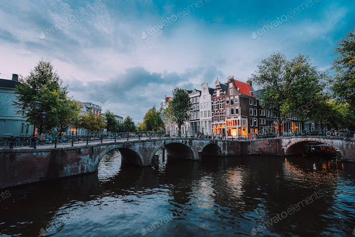 Bridge over Keizersgracht Emperor's canal in Amsterdam, dutch scene at twilight, Netherlands