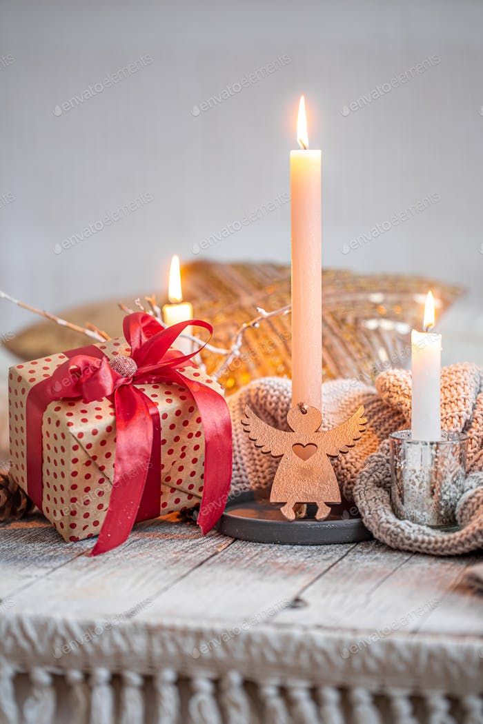 Cozy festive still life with a gift and a candle