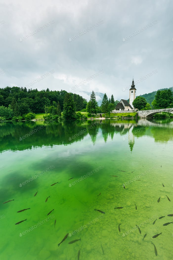 Cristal clear water and Church of Sv. John the Baptist  by the B