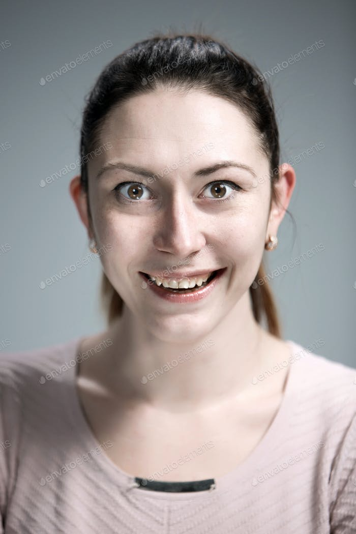 The happy woman on gray background