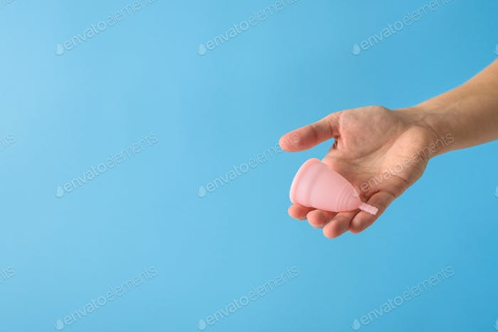 Hand holding menstrual cup