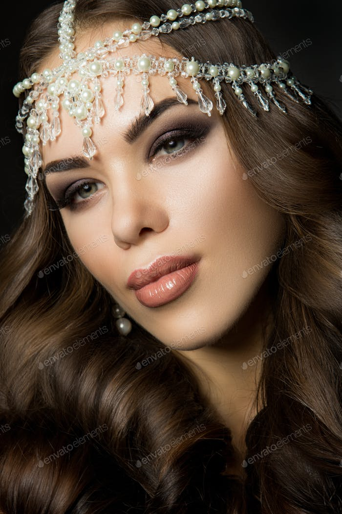 Beautiful bride with wedding makeup and hairstyle, attractive newlywed woman