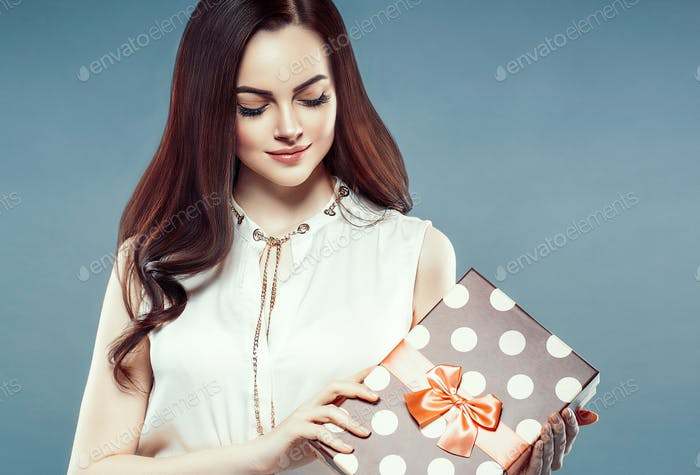 Woman with gift box beautiful portrait.