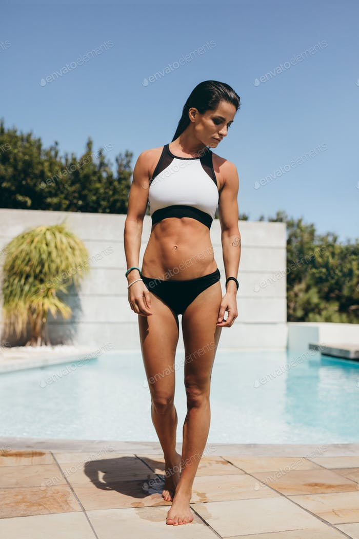 Thumbnail for Fit female athlete after a swim in pool