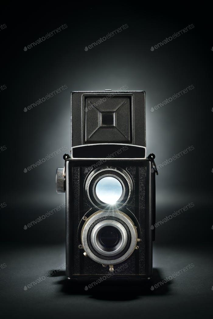 Old medium format camera on black