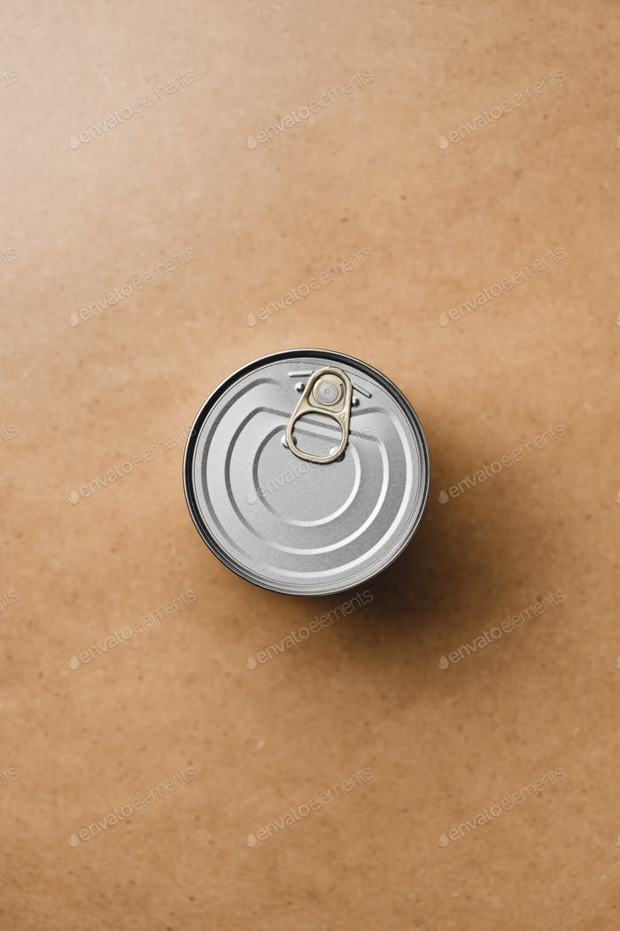 Top view on a canned food on a beige background. Minimal style food photography.