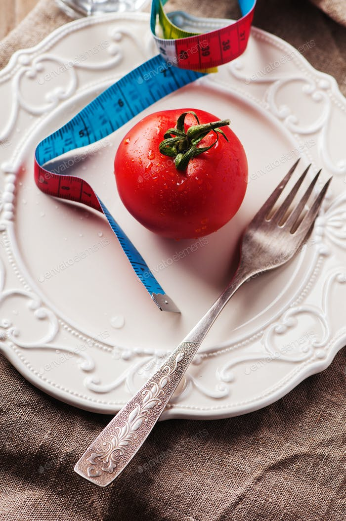 Concept of diet with red tomato and water