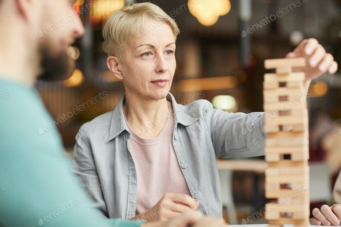 Woman playing in board game