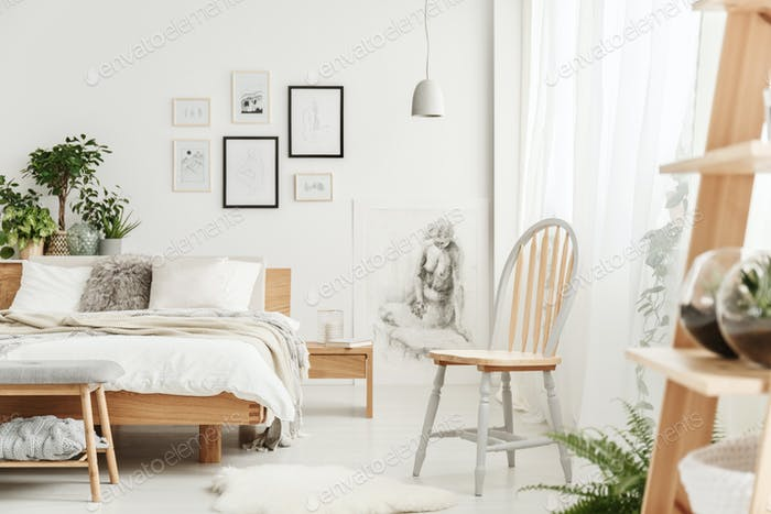 Wooden chair in natural bedroom