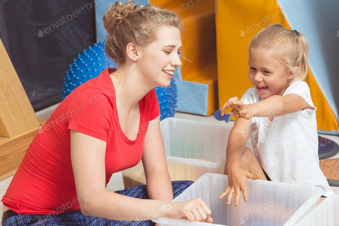 Child searching for objects on sensory integration class