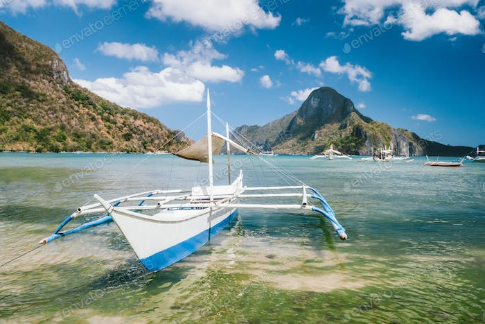 White boat in El Nido bay and Cadlao island, Palawan, Philippines