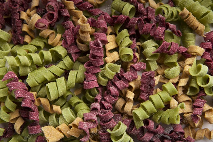 Mixture of colorful fusilli isolated on white