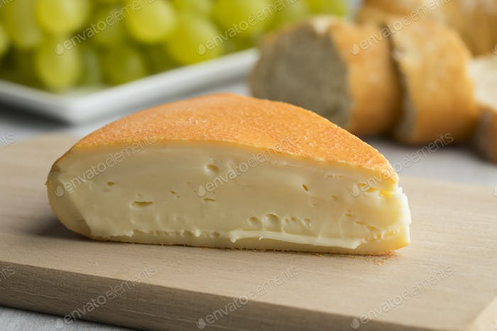 Piece of creamy French Chaumes cheese