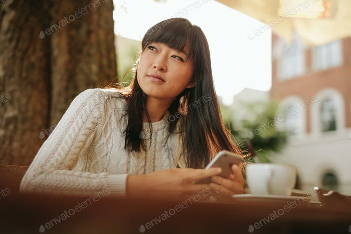 Beautiful young asian woman at outdoor cafe
