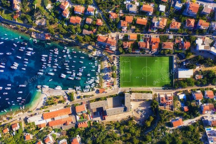 Croatian seascape from air. Yacht and football stadium. Hvar island
