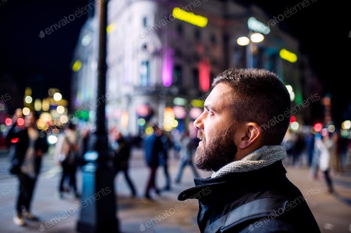 Man walking in the streets of London at night