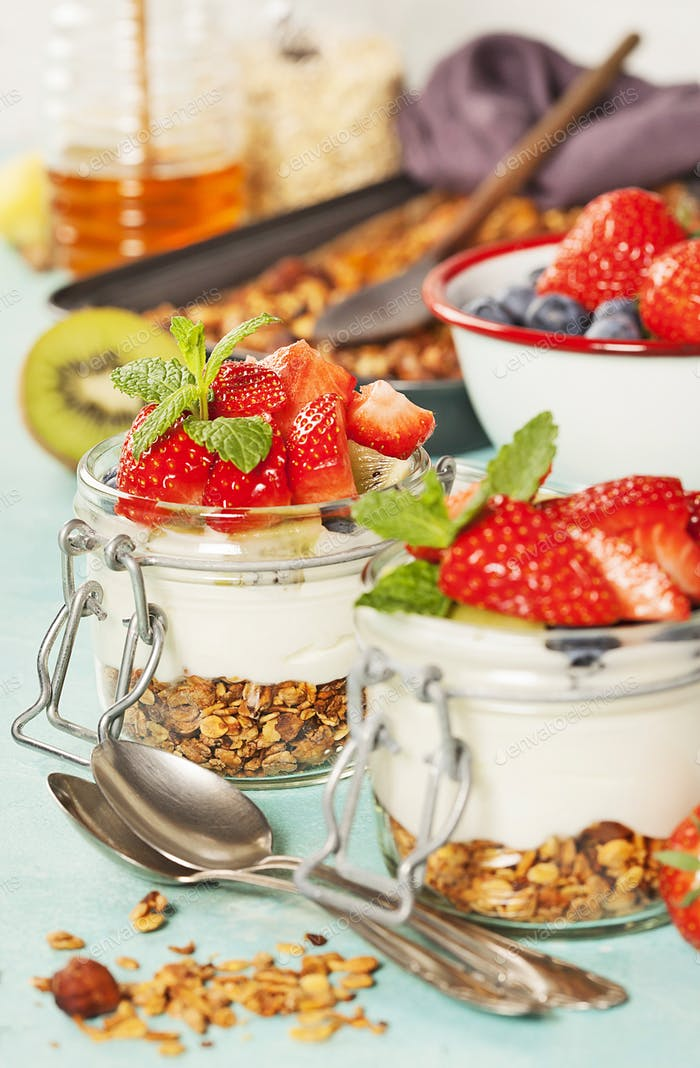 Healthy breakfast. Homemade yogurt parfait with granola, berries