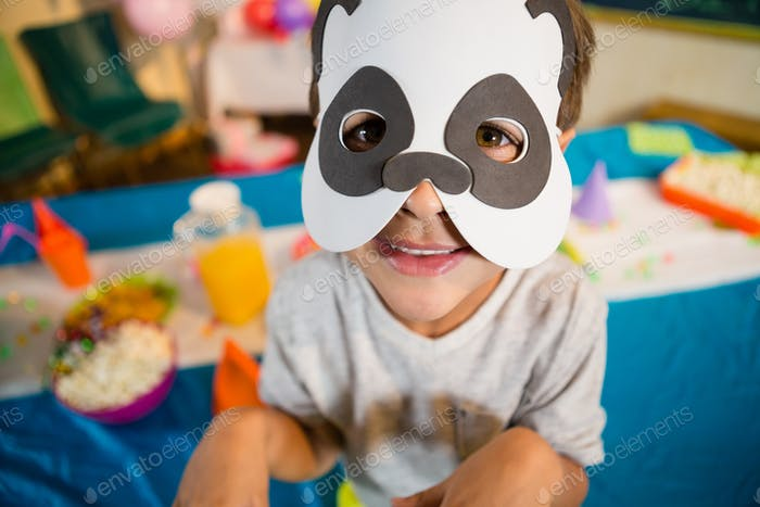 Boy pretending to be a dog during birthday party