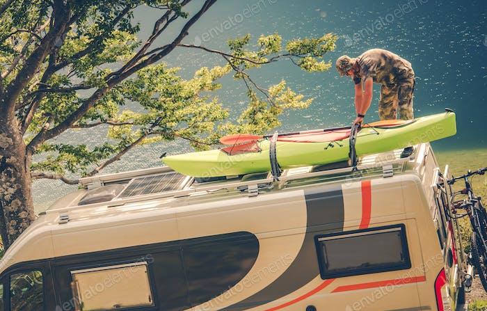 Men Installing Kayak on the RV