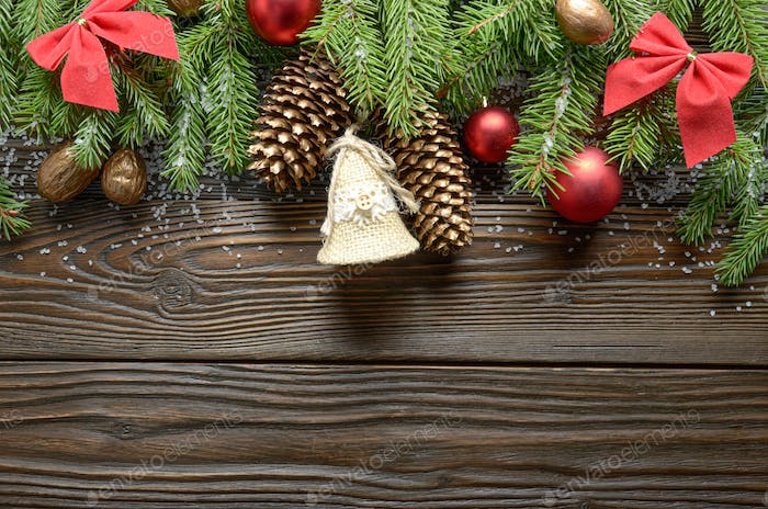 Top view at Christmas background of twigs, baubles and handmade decorations with copy-space