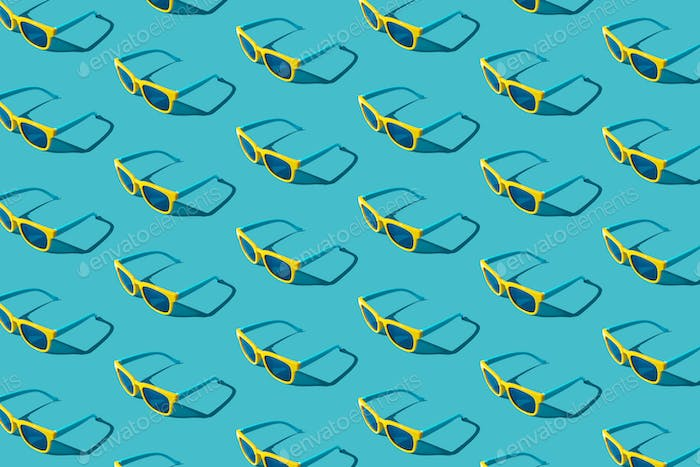 Plastic Sunglasses Pattern On Turquoise Blue Background With Hard Shadow