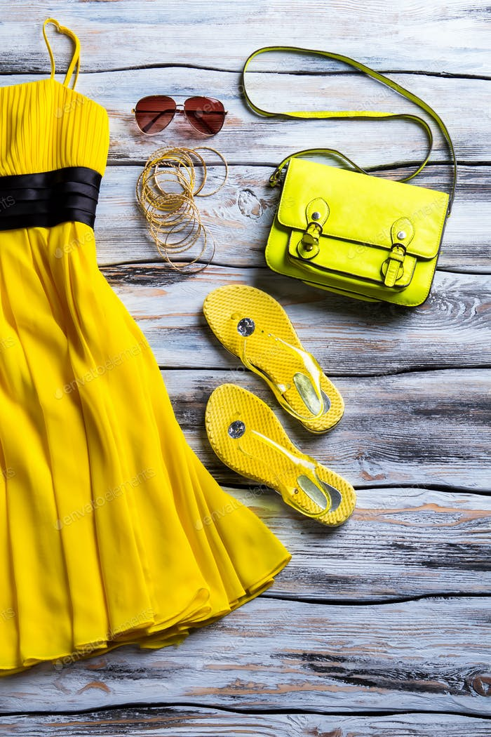 Yellow dress with lime purse.