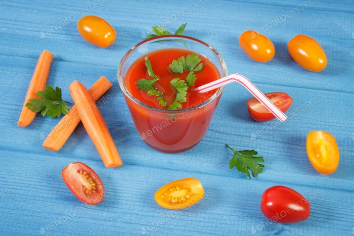 Tomato juice and vegetables with spices on boards, concept of healthy nutrition