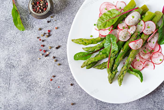 Salad from asparagus with radish and chard. Vegan cuisine. Healthy food. Flat lay. Top view