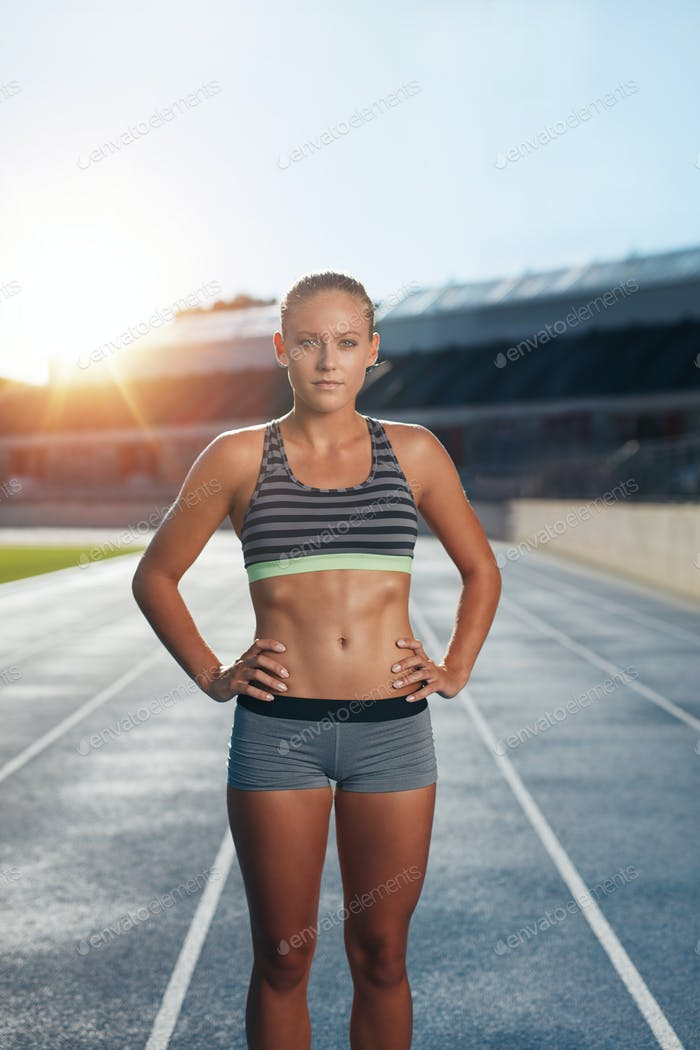 Fit young woman after run on race track