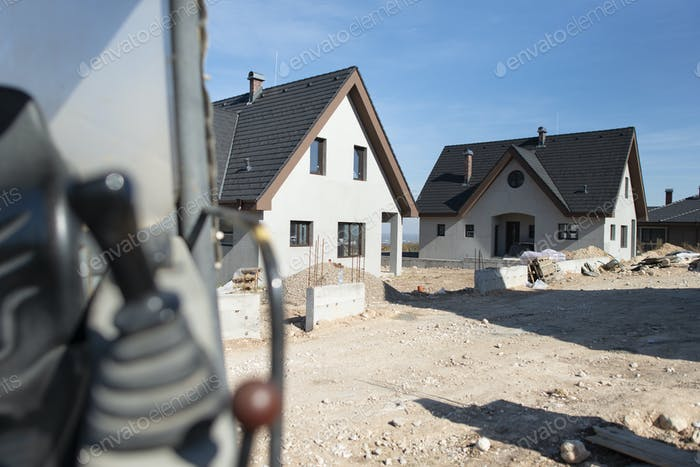 Excavator and new built houses