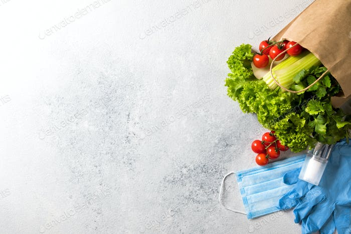 Concept of safe shopping at grocery stores during a pandemic. Vegetables are green vitamins .