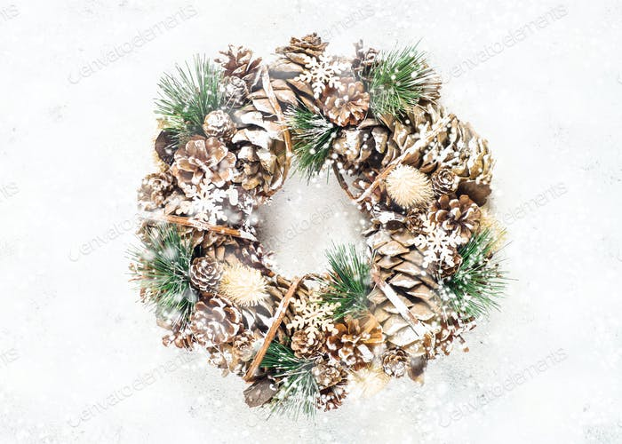 Christmas wreath on white top view.