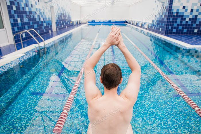 Sport active lifestyle. Sporty man male swimmer muscular fit body preparing to jumping and diving