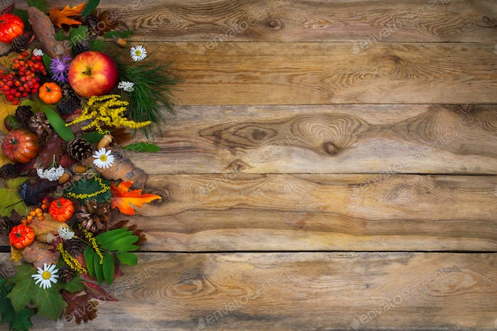 Thanksgiving  greeting with pumpkin, apples and green leaves on