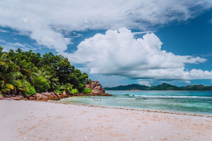 Cloudscape over tropical severe beach at La Digue island, Seychelles