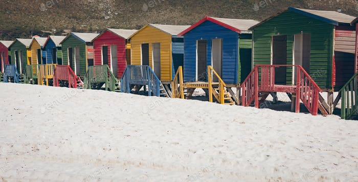 Colorful beach huts on the beach on a sunny day