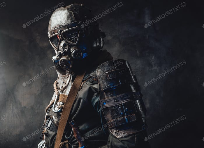 Survivor dressed in custom dark armour and gas mask