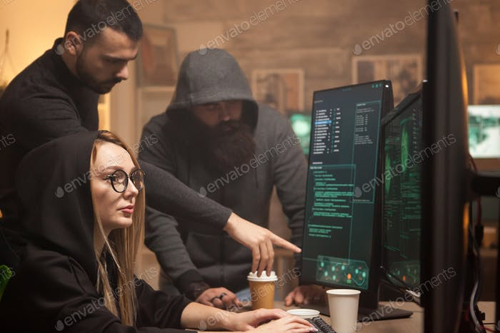 Young hacker working together with cyber terrorists