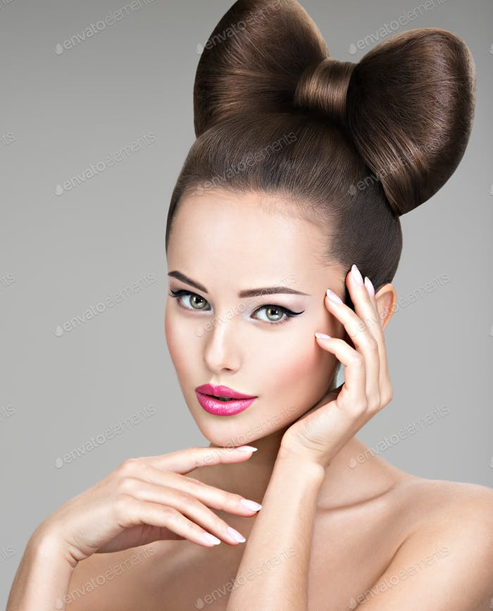 Beautiful woman with stylish bow hairstyle.