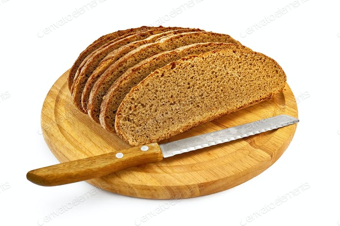 Rye bread on a round board with a knife