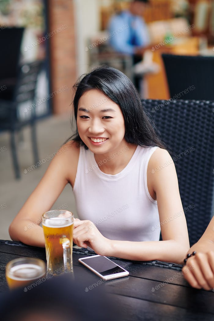 Asian woman sitting in cafe