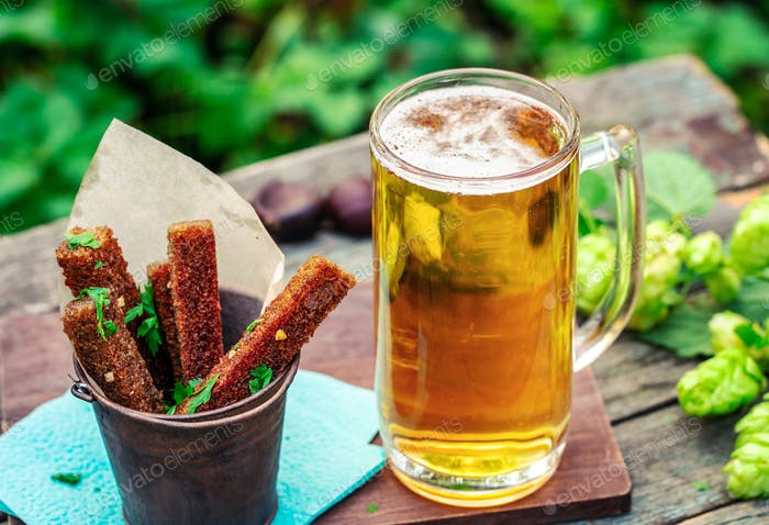 Beer with garlic rye croutons outdoors